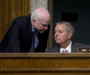 Senate Armed Services Committee Chairman Sen. John McCain, R-Ariz., left, speaks with Sen. Lindsey Graham, R-S.C., during the Senate Armed Services Committee hearing on Capitol Hill in Washington, Tuesday, July 7, 2015.