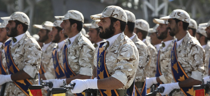 In this Sept. 22, 2011 photo, members of Iran's Revolutionary Guard march in front of the mausoleum of the late Iranian revolutionary founder Ayatollah Khomeini, just outside Tehran, Iran.