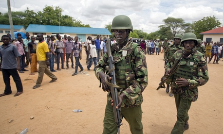 In this photo taken Saturday, April 4, 2015, Kenya Defence Forces (KDF) soldiers arrive at a hospital to escort the bodies of the attackers to be put on public view, in Garissa, Kenya.