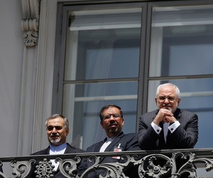Iranian Foreign Minister Mohammad Javad Zarif reacts as he stands on a balcony with other members of his delegation outside of the current round of Iran nuclear talks, being held in Vienna, Austria July 10, 2015.