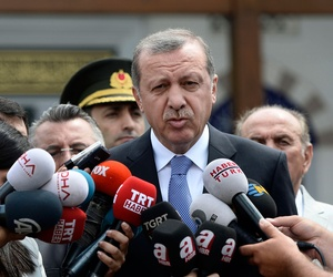 Turkish President Recep Tayyip Erdogan speaks to the media in front of a mosque in Istanbul, Turkey, Friday, July 24, 2015.