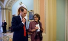Sen. Ron Wyden, D-Ore., left, walks with Sen. Dianne Feinstein, D-Calif. on Capitol Hill in Washington, June 27, 2013.