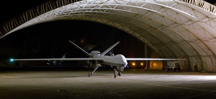 An MQ-9 Reaper remotely piloted aircraft prepares to taxi out of a hangar, Aug. 8, 2008.
