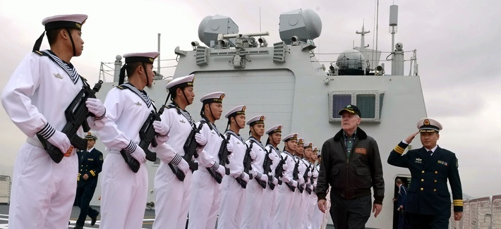 Chinese sailors render honors to Secretary of the Navy (SECNAV) the Honorable Ray Mabus during a visit to the People's Liberation Army Navy hospital ship Peace Ark.
