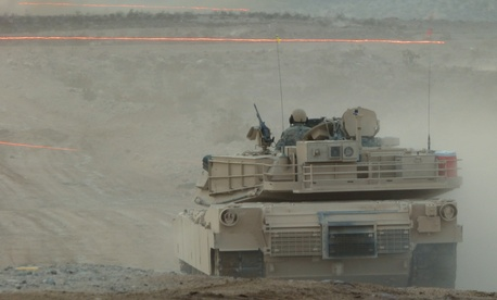 Tracer fire whizzes by an Army Abrams tank during a Joint Forcible Entry Exercise on Aug. 5.