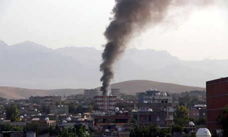 Smoke billows from a fire during firefight between the police and Kurdistan Workers' Party, or PKK militants in the town of Silopi, southeastern Turkey, Friday, July 7, 2015.