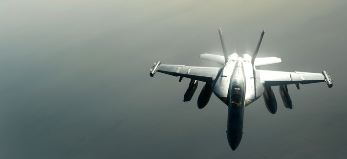 A U.S. Navy EA-18G Growler waits to be refueled by a U.S. Air Force KC-135 Stratotanker over Southwest Asia in support of Operation Inherent Resolve, Aug. 20, 2015.