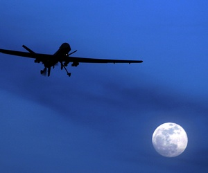 An unmanned U.S. Predator drone flies over Kandahar Air Field, southern Afghanistan, on a moon-lit night in 2010.