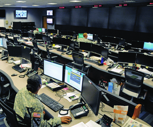 Uniformed and civilian cyber and military intelligence specialists monitor Army networks at Fort Gordon, Ga.
