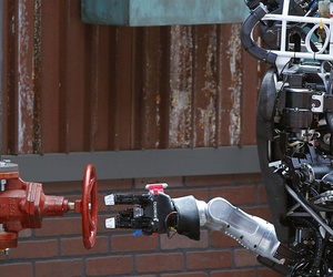Robot Running Man from the Florida Institute for Human and Machine Cognition proceeds to turn a valve in the U.S. Defense Advanced Research Projects Agency Robotics Challenge in Pomona, Calif.