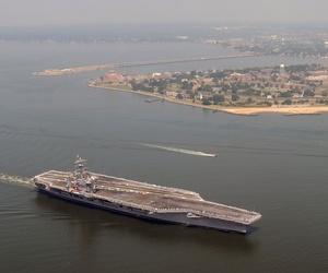 The Nimitz-class aircraft carrier USS Dwight D. Eisenhower (CVN 69) departs Naval Station Norfolk, June 20, 2012.