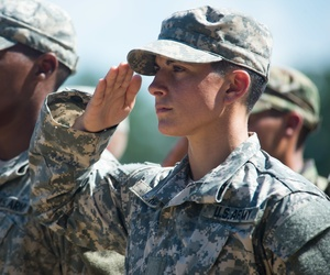Capt. Kristen Griest and U.S. Army Ranger School Class 08-15 render a salute during their graduation at Fort Benning, Ga., Aug. 21, 2015. Griest and class member 1st Lt. Shaye Haver became the first female graduates of the school.