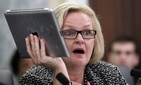 Sen. Claire McCaskill, D-Mo., holds up her Apple IPad during a hearing of the Subcommittee on Consumer Protection, Product Safety, and Insurance on cell phone privacy on Capitol Hill Thursday, May 19, 2011 in Washington.