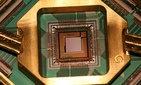 A quantum computing processor from the company D Wave, the Washington C16.