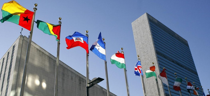 Flags fly in the north end of the United Nations building on a sunny fall day in New York City, Oct. 9, 2006.