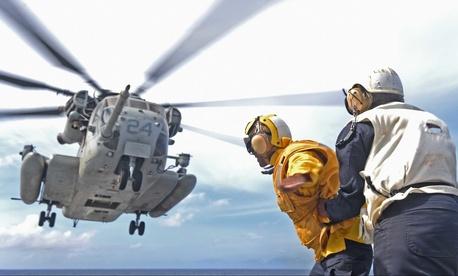 In the Pacific Ocean, a CH-53E Super Stallion lifts off the flight deck of the amphibious dock landing ship USS Ashland (LSD 48), Aug. 17, 2015.