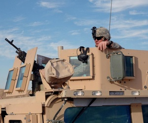 Soldiers use the Objective Gunner Protection Kit mounted on an M114 Humvee in Iraq. The OGPK was named one of the Army's 10 Greatest Inventions for 2007. Rock Island Arsenal produced approximately 28,000 OGPKs.