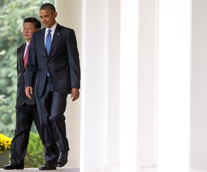 President Barack Obama and Chinese President Xi Jinping walk to the Rose Garden of the White House in Washington, Friday, Sept. 25, 2015, for their joint news conference.
