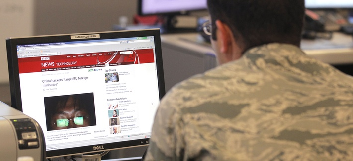 A staff member checks a news site at the NATO Computer Incident Response Capability (NCIRC) technical center, at NATO's military headquarters SHAPE in Mons, southwestern Belgium, Tuesday, Dec. 10, 2013.