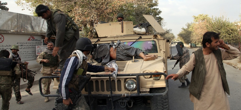 Afghan security forces take a wounded civilian man to the hospital after Taliban fighter's attack, in Kunduz city, north of Kabul, Afghanistan, Saturday, Oct. 3, 2015.