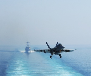 A U.S. Navy F/A-18F Super Hornet aircraft prepares to land on the flight deck of the aircraft carrier USS George H.W. Bush (CVN 77), not shown, in the Persian Gulf Oct. 3, 2014, in operations against the Islamic State in Iraq and Syria.