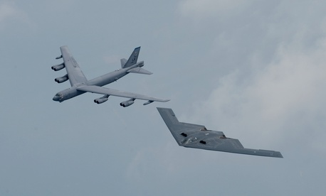 BARKSDALE AFB, La. -- A B-2 and B-52 fly in formation over Shreveport, La., on May 10 during the Defenders of Liberty Airshow and Open House.