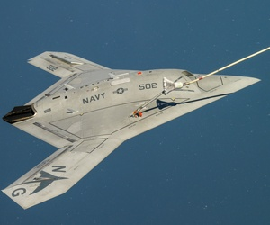 The Navy's unmanned X-47B receives fuel from an Omega K-707 tanker while operating in the Atlantic Test Ranges over the Chesapeake Bay. This test marked the first time an unmanned aircraft refueled in flight.