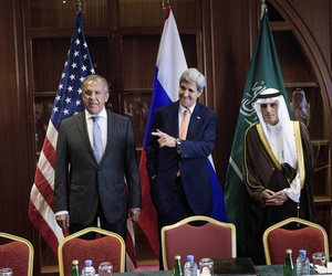n this Monday Aug. 3, 2015 file photo, Russia's Foreign Minister Sergey Lavrov, from left, U.S. Secretary of State John Kerry and Saudi Foreign Minister Adel al-Jubeir stand together before a trilateral meeting in Doha, Qatar.