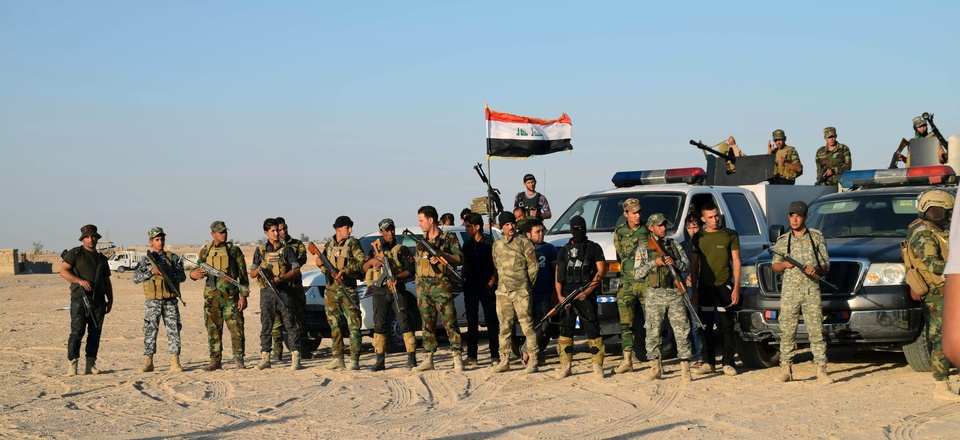 Sunni volunteer tribal fighters in the eastern suburbs of Ramadi, the capital of Iraq's Anbar province, Oct. 11, 2015.