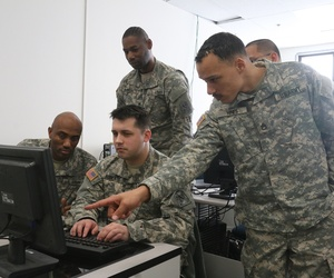 Lt. Gen. Edward C. Cardon, Commanding General of U. S. Army Cyber Command, visits the Virginia National Guard's Fairfax-based Data Processing Unit to learn more about the organization's cyber capabilities.