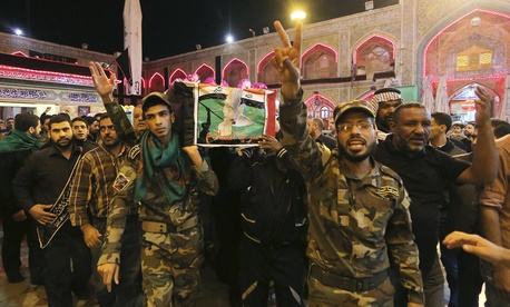 Iraqi fighters of the Peace Brigades, a Shiite militia group loyal to cleric Muqtada al-Sadr, angry after two of their members were killed in Ramadi during fighting with Islamic State militants, Nov. 7, 2015.