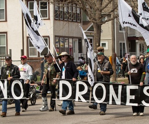 A protest of drones at the Minneapolis MayDay Parade and Festival 2013.