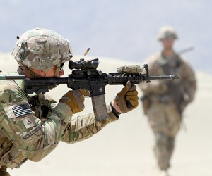 A U.S. Army Soldier, assigned to 3rd Brigade Combat Team, 101st Airborne Division, fires an M4 carbine rifle during partnered live fire range training at Tactical Base Gamberi, Afghanistan, May 29, 2015.