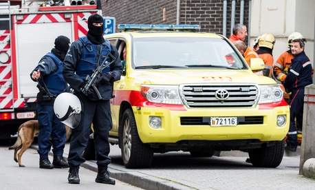 Armed police guard a street in Brussels on Monday, Nov. 16, 2015.