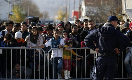 Migrants wait to register with the police at the refugee center in the southern Serbian town of Presevo, Monday, Nov. 16, 2015.
