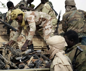 Chadian soldiers collect weapons seized from Boko Haram fighters in the Nigerian city of Damasak, Nigeria, Wednesday March 18, 2015.
