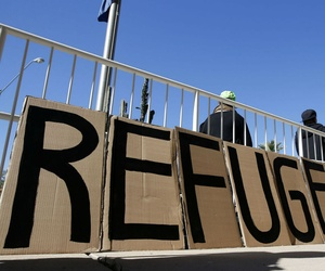 A sign welcomes Syrian refugees during a rally in Arizona. The governor has joined others in calling for a halt to placements of Syrian refugees there, following the Paris terrorist attacks.