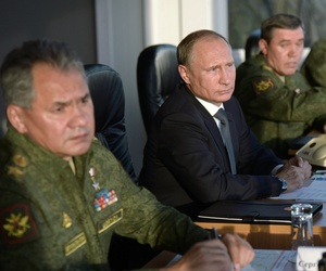 Russian President Vladimir Putin, second left, flanked by Defense Minister Sergei Shoigu, left, and Chief of the General Staff of the Russian Armed Forces Valery Gerasimov.