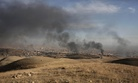 Smoke rises over Sinjar, northern Iraq from oil fires set by Islamic State militants as Kurdish Iraqi fighters, backed by U.S.-led airstrikes, launch a major assault on Thursday, Nov. 12, 2015.