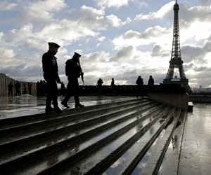 French soldiers patrol the Trocadero place near the Eiffel Tower, in Paris, Saturday, Nov. 21, 2015.