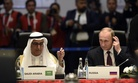 Saudi minister of finance Ibrahim bin Abdulaziz Al-Assaf, left, and Russia's President Vladimir Putin attend a working session at the G-20 Summit in Antalya, Turkey, Sunday, Nov. 15, 2015.