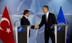 Turkish Prime Minister Ahmet Davutoglu, left, shakes hands with NATO Secretary General Jens Stoltenberg after addressing a media conference at NATO headquarters in Brussels on Monday, Nov. 30, 2015.