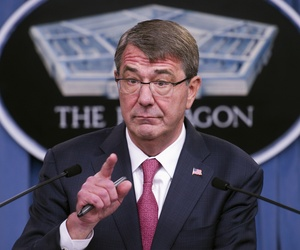 Defense Secretary Ash Carter gestures during a news conference at the Pentagon, Thursday, Dec. 3, 2015, to announce that he has ordered the military to open all combat jobs to women.