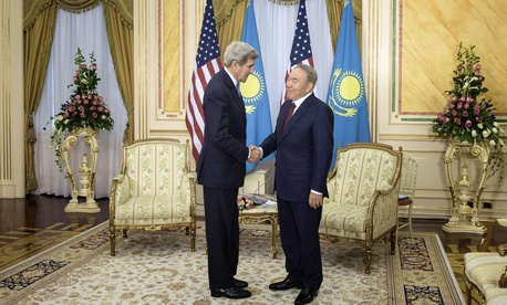U.S. Secretary of State John Kerry, left, and Kazakhstan's President Nursultan Nazarbayev shake hands before a meeting at the Presidential Palace Monday, Nov. 2, 2015 in Astana, Kazakhstan.