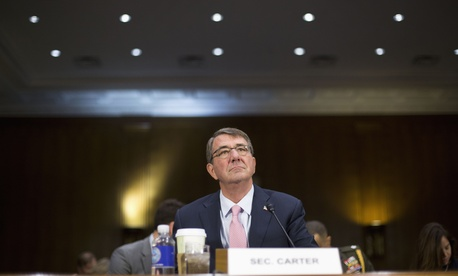 Defense Secretary Ash Carter arrives on Capitol Hill in Washington, Wednesday, Dec. 9, 2015, to testify before the Senate Armed Service Committee hearing on the Islamic State.