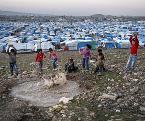In this Saturday, Nov. 28, 2015 photo, Syrian refugee children play at a temporary refugee camp in Irbil, northern Iraq.