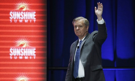 Republican presidential candidate, Sen. Lindsey Graham, R-SC, waves to the audience after addressing the Sunshine Summit in Orlando, Fla., Friday Nov. 13, 2015.
