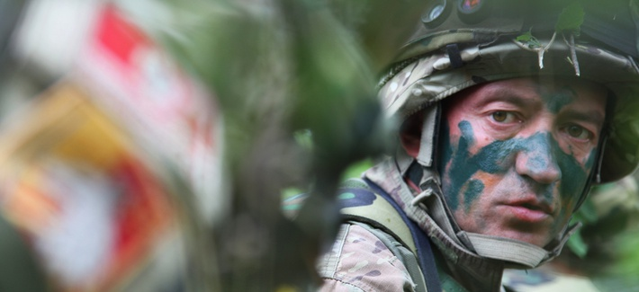 Montenegrin army Sgt. Radomir Drobac takes position as he waits for the opposing force in an ambush exercise during the Immediate Response 2012 training event held in Slunj, Croatia on Friday, June 1, 2012.