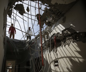 Men inspect a building damaged by a Saudi-led airstrike in Sanaa, Yemen, Tuesday, Jan. 5, 2016.