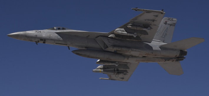 A U.S. Navy F/A-18F Super Hornet flies a combat sortie over Iraq July 2, 2015.